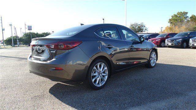 Прокат авто Mazda 3 серебристого цвета - фото 4
