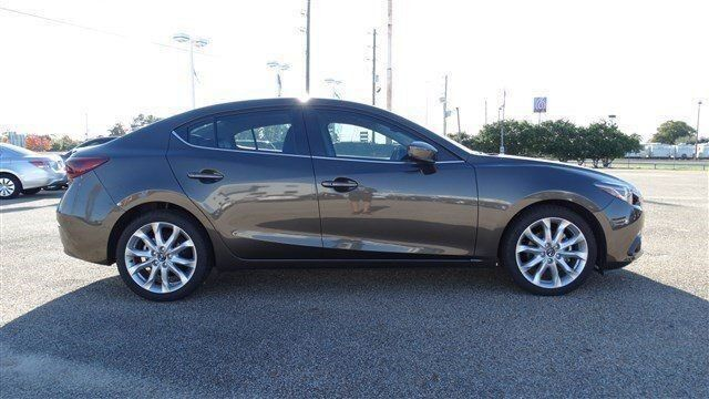 Прокат авто Mazda 3 серебристого цвета - фото 3