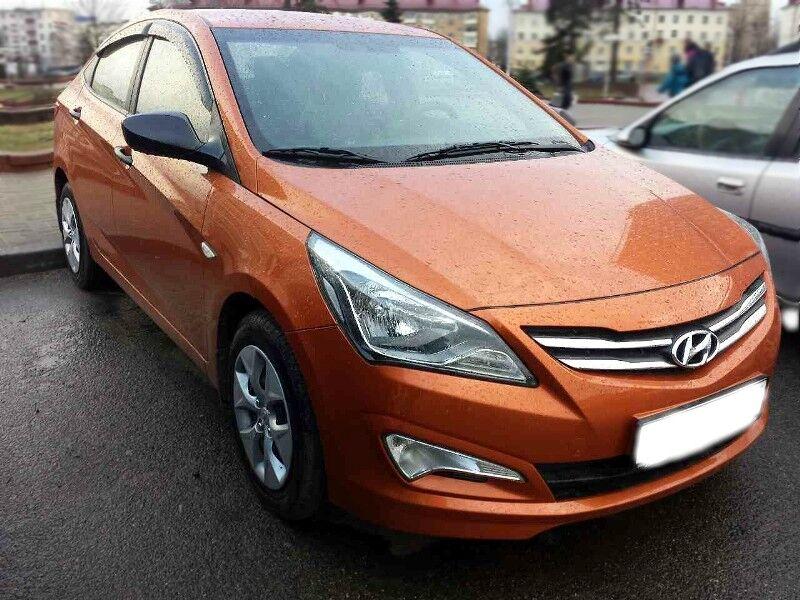 Прокат авто Hyundai Solaris 2015 г.в. оранжевый - фото 1