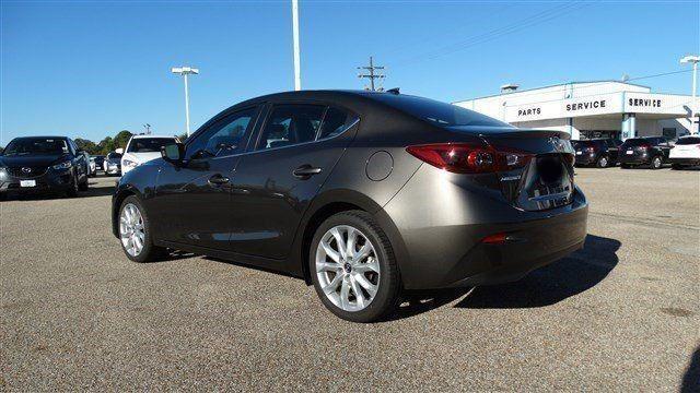 Прокат авто Mazda 3 серебристого цвета - фото 2