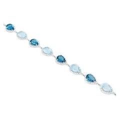 Ювелирный салон Evora Браслет из серебра 925 пробы с синими топазами Лондон блю, голубыми топазами и фианитами 624394